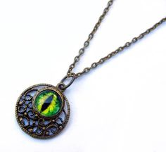 Antiqued Brass Filigree Green Evil Dragon Glass Taxidermy Eye Pendant with Chain Necklace by Nixcreations, $18.00