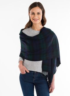 Blarney Heritage Black Watch Shawl - enjoy the quality of fine merino lambswool, woven in a classic Scottish black watch tartan. The low key colors featured in this tartan historically benefited for camouflage when out hunting. The understated shades of blue, green and black make an elegant shawl that will compliment any ensemble.