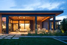 Using the same materials inside and out: Cedar T&G siding, buff sandstone and br. - Using the same materials inside and out: Cedar T&G siding, buff sandstone and bronze accents the li - Flat Roof House, Facade House, Modern Bungalow Exterior, Single Floor House Design, Modern Floor Plans, Home Fashion, Style At Home, Interior Architecture, House Styles