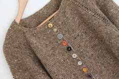 This pic comes from a site that is not in English but the sweater is so cute I had to pin it. Look at all the different buttons!
