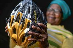 A @Wildlands Waste-preneur proudly holds her new Qhubeka Bicycle Helmet. Picture credit: KELVIN TRAUTMAN