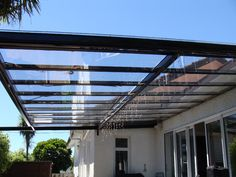 Extraordinary Pergola Covers Designs For Your Home Outdoor Ideas: White Theme Wall Design Ideas With Glass Window Plus Pergola Covers For Modern Patio Decor