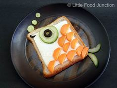 Little Food Junction: zoo sandwiches bread, cheese, carrot, cucumber, olives.