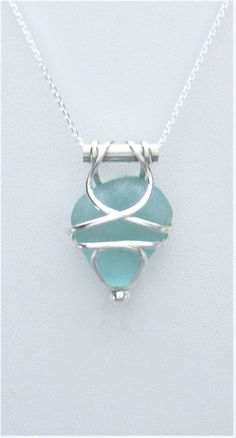 9a6f01eaace3d9 Sea Glass Jewelry - Sterling Caged Aqua Sea Glass Necklace by SignetureLine  on Etsy #seaglassearringsideas