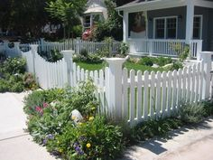Very pretty idea with the small rock gardens at different spots around the fence!