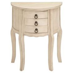 """Showcasing a scalloped apron and cabriole legs, this demilune wood nightstand features 3 drawers and a soft cream finish.     Product: NightstandConstruction Material: WoodColor: Soft creamFeatures:  Three drawersScalloped apronDemuline designCabriole legs Dimensions: 28"""" H x 22"""" W x 12"""" D"""