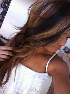 Brown hair with blonde highlights, dark brown/black lowlights.