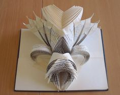 This Secondhand Store Volunteer's Book Folding Art Will Blow Your Mind! - Cube Breaker