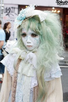RT @TokyoFashion: Japanese shironuri Minori on the street in Harajuku w/ antique fashion  flower petal makeup http://flip.it/pDwKp