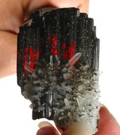 Stunning Hübnerite and Quartz minor dusting of Pyrite! Specimen shows deep red internal reflections when backlit. Huayllapon Mine, Peru