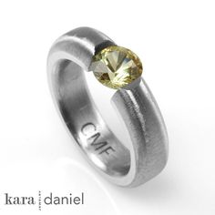natural yellow sapphire ~ tension-set in stainless steel engagement/wedding ring. by kara | daniel, via Flickr