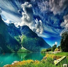 Norway In Summer | Summer in Norway - this picture, the beautiful alps, the clouds, color of the water - everything about this picture is amazing!