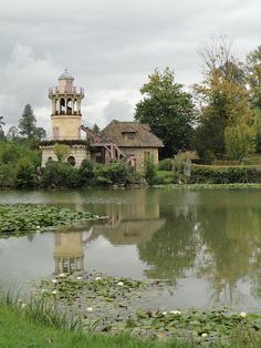 Le Hameau--Marie Antoinette's hamlet, a fully functioning village on the grounds of Versailles. The architect was executed during the Reign of Terror.