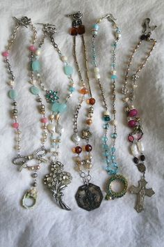 Love the fun colors of the beads and the found object pendants on these necklaces