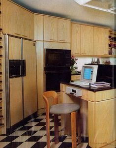 1984 great floor, awful cabinets However, in the '80s, we see the rise of two things: laminate and technology. This kitchen was very cutting edge at the time (though we're still not sure if working where you cook is such a great idea).