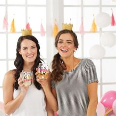 """This 2-piece set includes a stemless wine glass with a festive wearable birthday hat. The glass features gold foil embellished """"It's The Big THREEOH!"""" message."""
