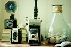 Looking for a camera like the one in the middle & just added the one on the right to my collection