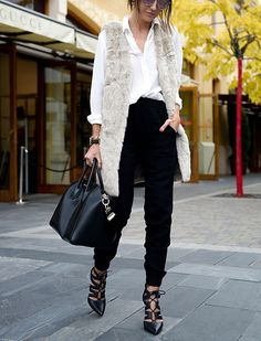 I just love this look - maybe shirt untucked! 15 Incredibly Chic Winter Outfit Ideas via @PureWow