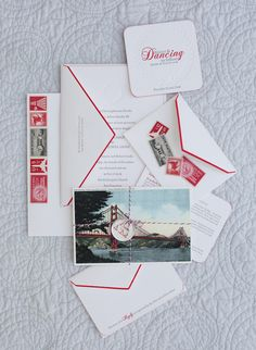 love this vintage look postcard for the save the date and the envelopes are hand painted with the red. Simple but very elegant.