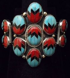 Cuff | O Moses. (Navajo)   Silver, turquoise, coral and jet.