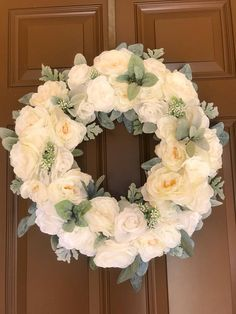 This gorgeous white and green floral wreath is the perfect way to welcome your guests!! It will brighten up any door! Made to order. Each wreath is made with the same florals and technique but as with all handmade goods, finished products will vary. I will send you progress photos