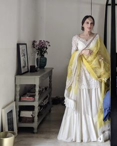 Bride in a short white kurta and sharara pants on her haldi function - indian fashion Sharara Designs, Lehenga Designs, Dress Indian Style, Indian Fashion Dresses, Indian Designer Outfits, Indian Outfits, Mehendi Outfits, Indian Gowns, Indian Attire