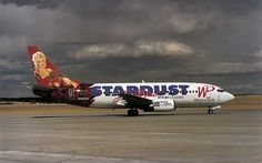 Aki Alma, a showgirl at Stardust Hotel-Casino, Las Vegas, stands on the wing of a Boeing 737 with her 37-foot likeness in the background. The plane was part of the Western Pacific Airline's 'AirLogo' programme from the mid-1990s, in which the carrier used the exteriors of its aircraft for advertising. Picture: Airline: Style At 30,000 Feet' by Keith Lovegrove and published by Laurence King Publishing