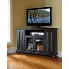 Enhance your living space with Thome Furniture's impeccably-crafted - Cambridge Corner TV Stand. The Thome - Cambridge Corner TV Stand accommodates most flat panel TVs, and is handsomely proportioned featuring charac Angles, Wood Corner Tv Stand, Corner Unit, Consoles, Black Entertainment Centers, Tv Stand Designs, Cool Tv Stands, Raised Panel Doors, Diy Tv Stand