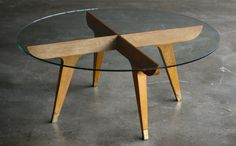 1960 Gio Ponti coffee table in oak and brass with a glass top.