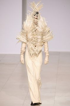 Wearable Art - long dress with dramatic feather structure encasing the face and torso - body sculpture; 3D fashion // Peachoo + Krejberg AW12