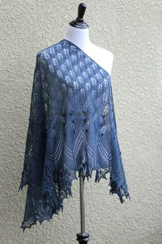 This hand knit #shawl is made of 50% merino/50% tencel in grey blue color. It's…