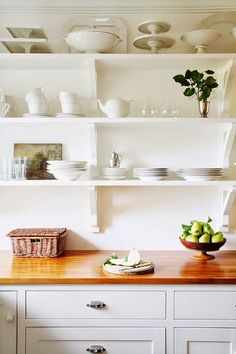 In our old house, we used Benjamin Moores Simply White on everything...Cabinets, shelves, walls,...
