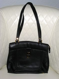 'Etienne Aigner Black Leather Tote EUC' is going up for auction at  3pm Sun, Aug 25 with a starting bid of $80.