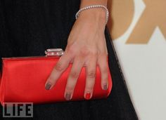 Kaley Cuoco's manicure at the Emmys - gray with one nail painted red. I don't know why, but I love this.