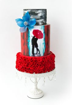 Kissing in the Rain under red umbrella / Red Ruffled Frosting / Cake Artist: Hazel Wong / Opulent Treasures White Chandelier Cake stand