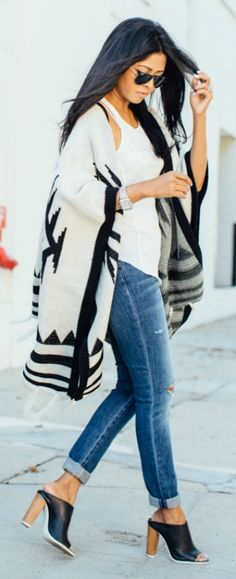 A black and white poncho will look the best with a pair of distressed skinnies and a white tee. Via Sheryl Luke  Poncho: Nordstrom Rack, Jeans: Joes Jeans, Shoes: Vince