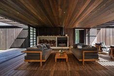CAAHT Studio Architects created a retreat consisting of two gable cabins in Matarangi, a town on the Coromandel Peninsula of New Zealand. Indoor Outdoor Living, Outdoor Rooms, Cedar Cladding, Living In New Zealand, Architecture Awards, Modern Architecture, Open Fireplace, Cabin Design, Cabin Homes
