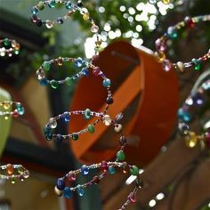 memory wire and beads for beautiful window decorations :)  Put a bell at the end for a wind chime