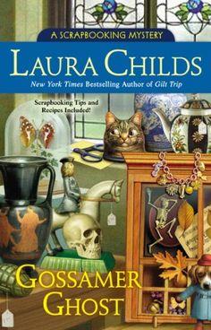 Gossamer Ghost (A Scrapbooking Mystery) by Laura Childs,http://www.amazon.com/dp/0425266664/ref=cm_sw_r_pi_dp_tbUstb1W1CGFJYYE