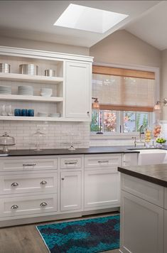 White kitchen cabinets with black honed granite countertop. Kitchen Interior, White Kitchen, Interior, Beautiful Interiors, Kitchen Remodel, Kitchen Cabinet Remodel, Home Kitchens, Kitchen Style, Kitchen Design
