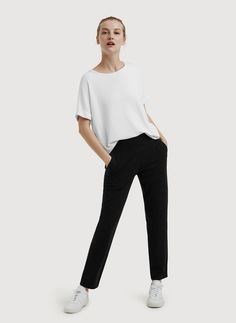 YOUR GO-TO. Wrinkle-resistant Kaymace™ fabric with four-way stretch and our signature flattering three-inch waistband (equipped with a hidden phone pocket) makes these your travel pant dream come true.