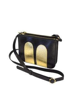 Mickey Handbag with adjustable shoulder strap and shiny golden details is made of 100% leather. There are two zipper pockets and one pocket in-between with a ma