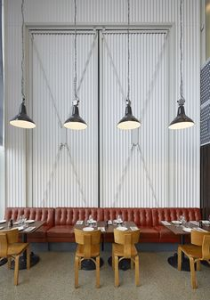 1950s pendant lights + vintage Thonet chairs at Oaxen in Stockholm.
