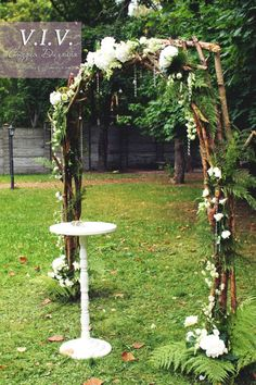 Love the construction of the arch and use of ferns.  (Not the danglee beads…