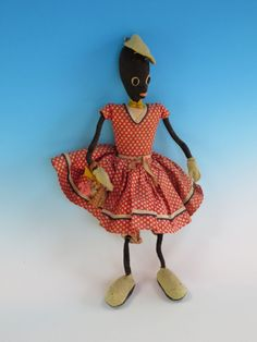 "This interesting black doll articulates well because arms and legs are done with a flexible material to bend into about any position imaginable. The body is sawdust filled and we think her mode of dress would date her circa 1900. An absolutely wonderful item of Black Americana,14 1/2"" in ht."
