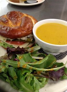 Lunchtime Trio - Homemade Soup, Pretzel Roll Sandwich, and Organic Salad Greens drizzled with Our House Vinaigrette :: Rolling Scones Bakery & Cafe located in Goshen, IN