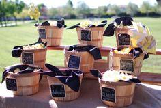 Potato chip buffet in bushel baskets with chalkboard tags, pinwheels, and burlap for a tablecloth