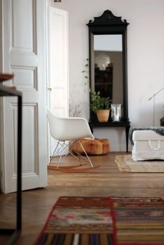 why is this so striking? is it the eclectic mix? the statement chair? I like