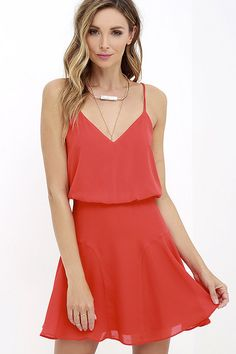 Why take a chance on anything else, when the Wanna Bet? Coral Red Sleeveless Dress is a surefire win?! Lightweight Georgette swings from dual spaghetti straps into a billowy triangle bodice with back slit. Curving seams contour the flaring skirt for a twirl-able finale. Hidden back zipper.