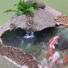 Realistic running stream made from tar gel enters a dollhouse scale koi pond.